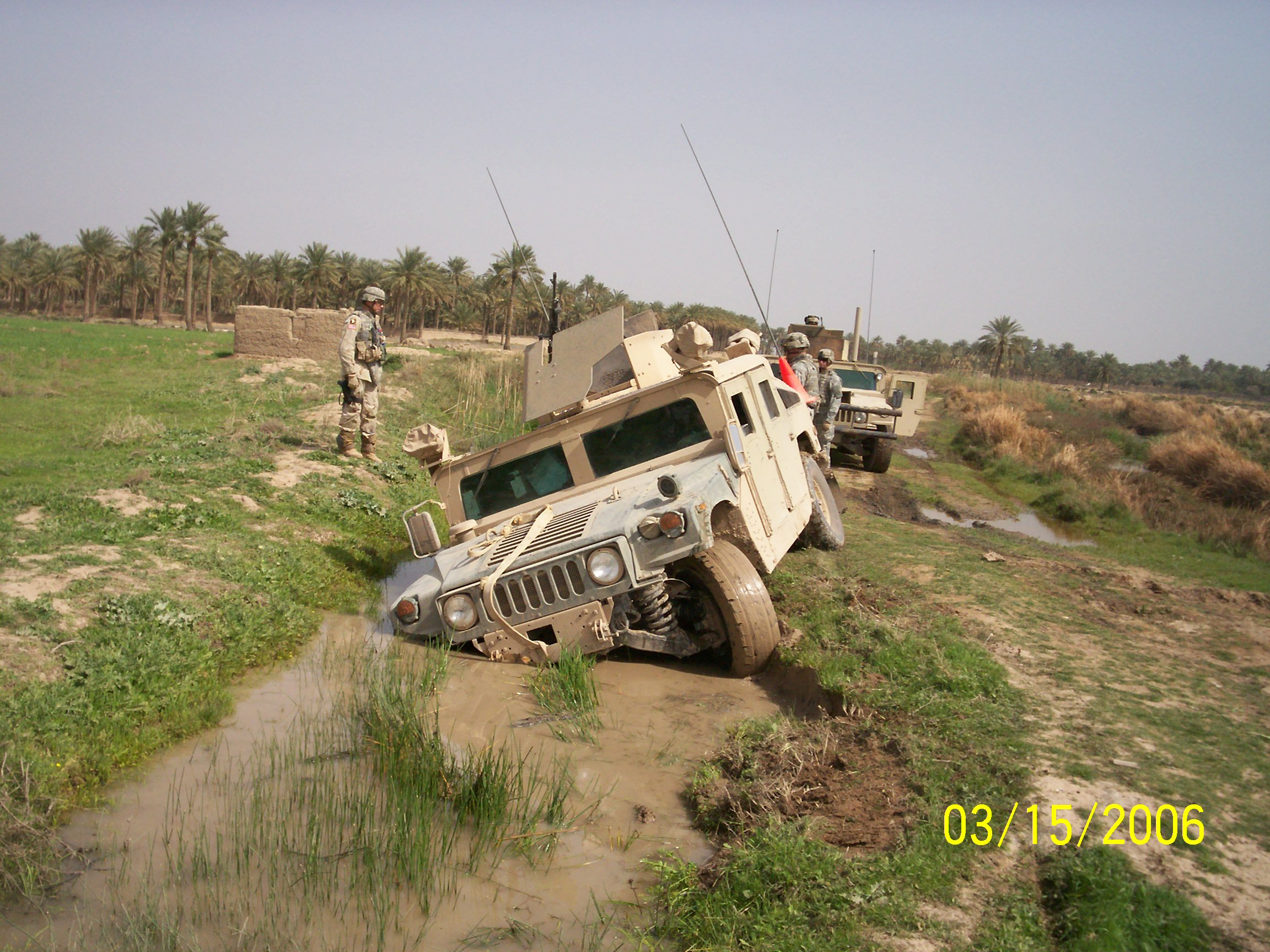 Fully armored Humvees weigh 10,000 pounds or more. They can easily get stuck in the mud and make for a very long and miserable day. Here is such a day.