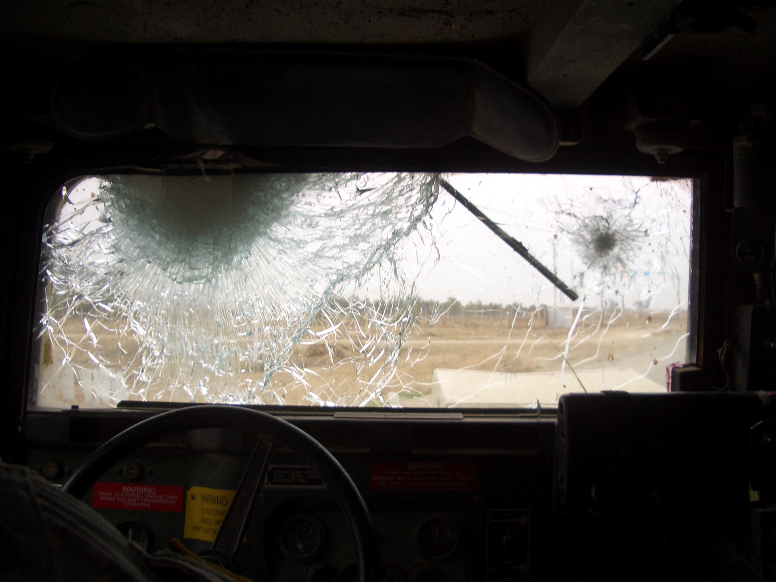 The armored glass windows of the Humvees can take some damage. The crew of this Humvee took a roadside bomb blast to the front, but everyone emerged mostly unscathed.