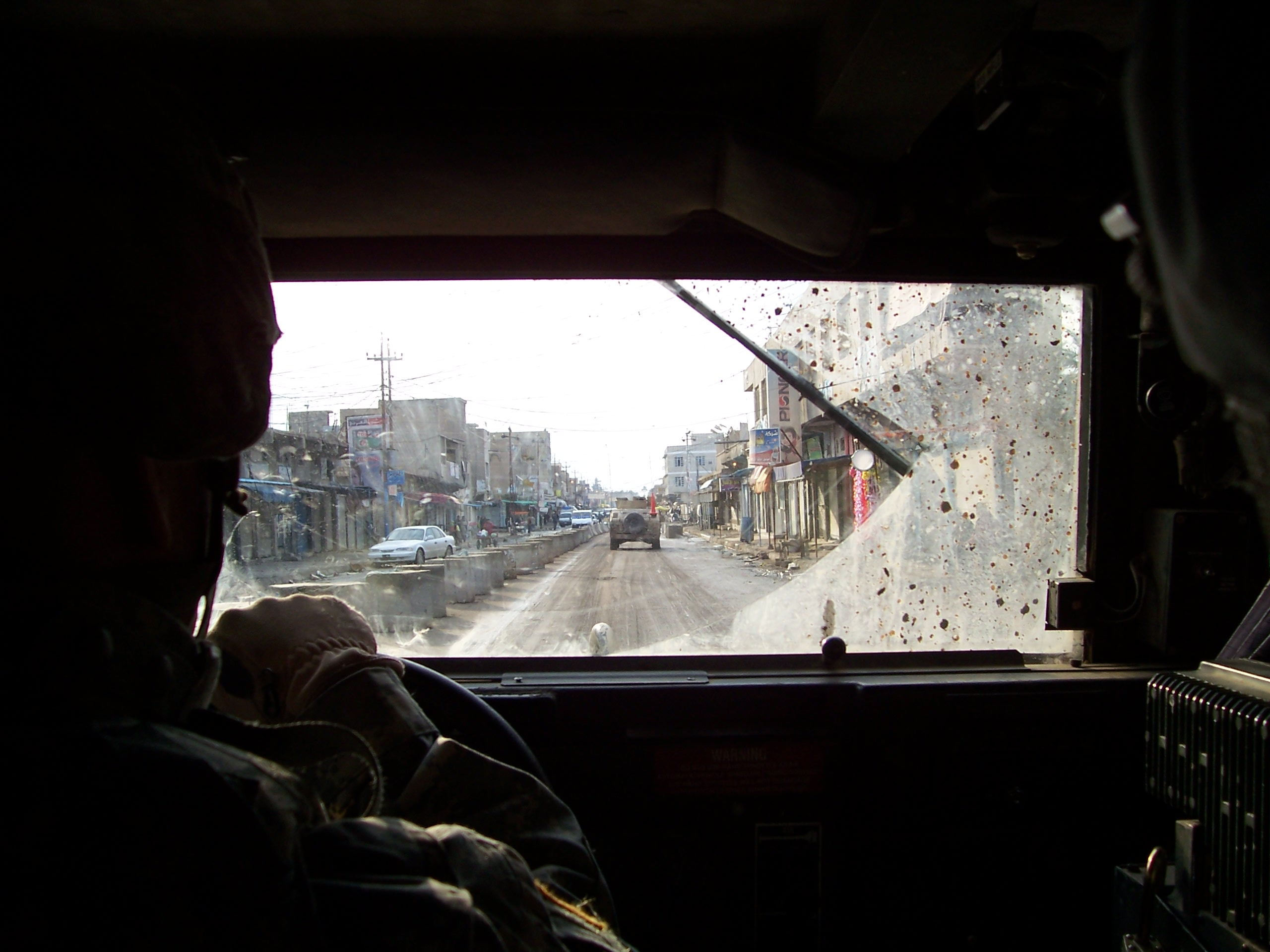 The driver's view of the world is small; his responsibilities are great, and privileges small, but driving in Iraq can be fun. Besides the ever-present threat of roadside bombs, Humvee drivers have to contend with the roads and drivers of Iraq.
